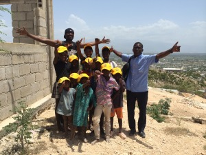One of our volunteers and one of our guides with some future students of a school we're helping to build in Cana'an.
